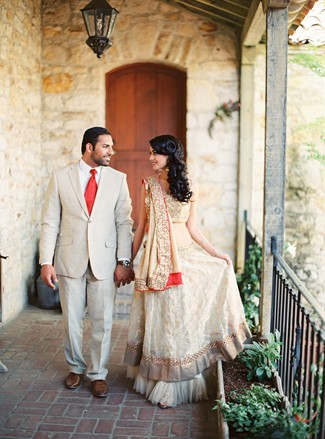 Indian bride and groom walking hand in hand. Bride in traditional Indian dress.