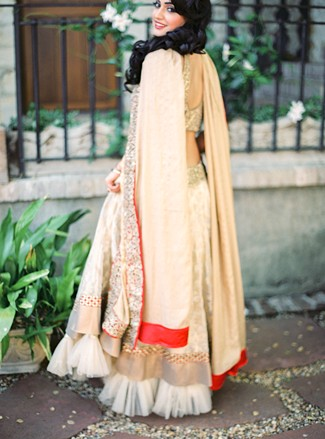 Indian bride standing and posing at Holman ranch wearing traditional Indian dress.