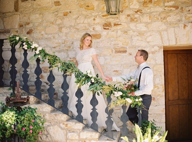 bride and groom on stairs at whimsical woodland love styled shoot