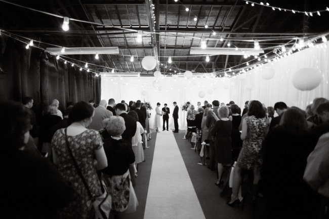 Wedding Ceremony At Royal Oak Farmers Market White Aisle Runner And Lanterns Up Above