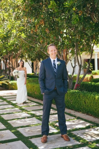 bride walking up to groom in blue suit and blue stripped necktie from express