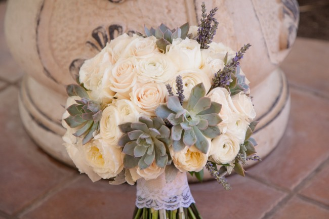 Bridal bouquet of white roses, white peonies, succulents, lavender lace wrapped stem