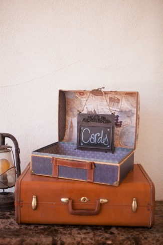 "brown and blue vintage suitcases with a chalkboard sign with ""cards"" written on it."