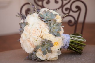 White roses, succulents and lavender bridal bouquet with stem wrapped in lace