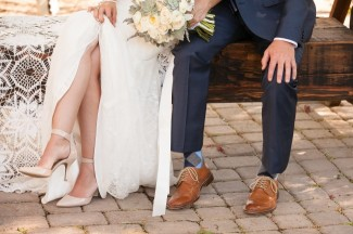 A photo of the bride and grooms feet. Grooms wearing brown banana republic shoes