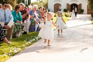 flower girls running down the aisle at Villa de Amore wedding ceremony