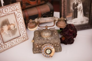 Vintage telephone and vintage family photos for wedding decor
