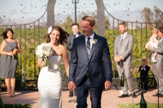 bride and groom recessional for wedding at Villa de Amore