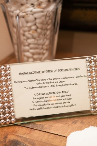 A silver frame with the explanation of Italian wedding tradition of Jordan almond