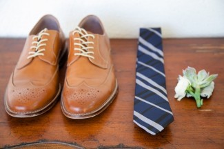 Blue stripped necktie from Express, brown dress shoes from Banana Republic, succulent boutonniere
