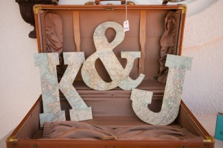 Vintage suitcase for guest cards with monogram initials of the bride and groom inside