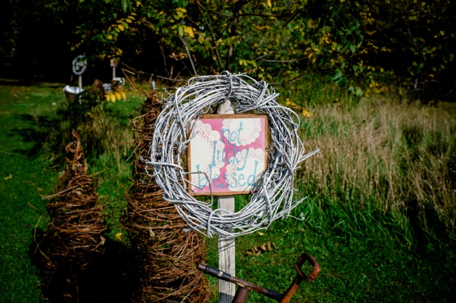 Rustic wedding sign with twig wreath at Apple Tree Lane Bed and Breakfast Wedding
