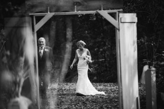 Black and white photo of bride and father walking to wedding ceremony at Apple Tree Lane B&B