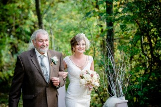 Bride walking down aisle with father at Apple Tree Lane Bed and Breakfast Wedding
