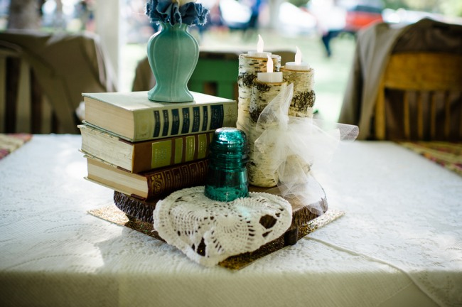 Vintage books, birch candle holders, green vase and doiley for wedding center piece