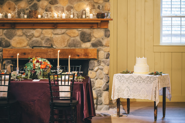 cake table with white lace next to fireplace