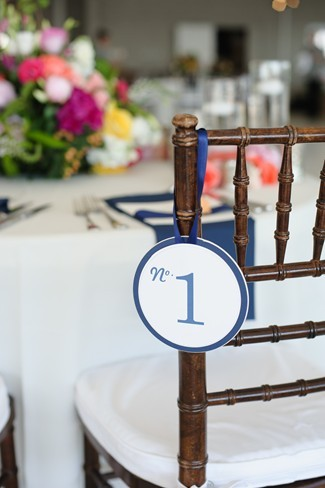 round blue and white sign with no. 1 hanging from a brown chevalier chair