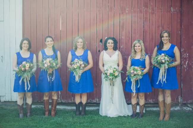 Bride Standing With Bridesmaids In Blue Dresses Brown Skinny Belt All Wearing Colored Cowboy