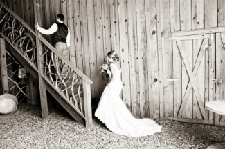 Bride walking up stairs to groom for first look at Price Mountain Farms Barn
