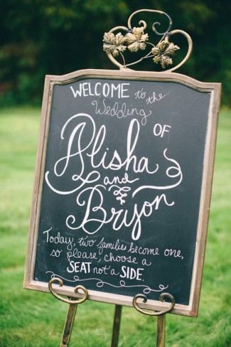 Chalkboard wedding welcome sign on an aisle