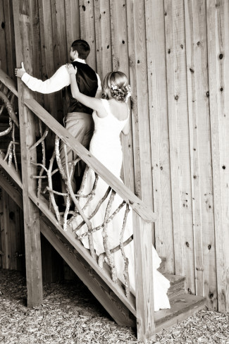 Bride tappin on groom's shoulder for first look at Price Mountain Farms Barn
