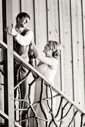 Groom turning around to look at bride for first look on stairs at Price Mountain Farms Barn