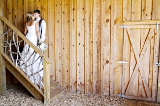 Bride and groom kissing on stairs after first look