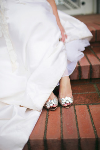 bride wearing badgley mischka peep toe shoes