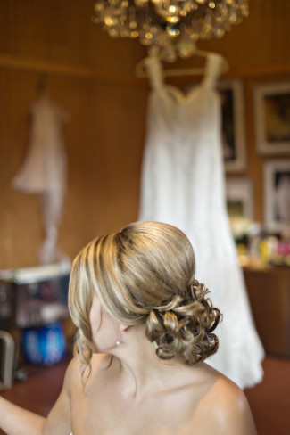 Blond bride with her hair curled into a low bun