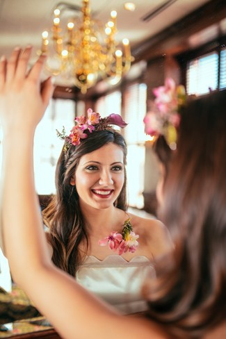 26 Bride wearing strapless gown and flower crown in her hair