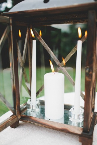 brown metal lantern with white candle