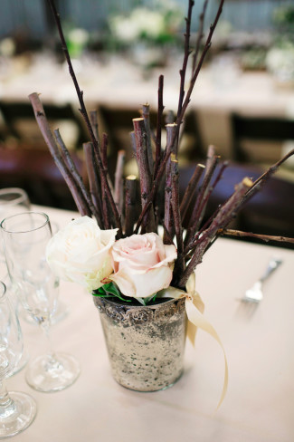 mercury vase with pink roses and wooden twigs