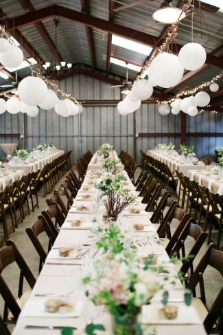 long row tables for wedding reception at PATRICK RANCH MUSEUM with white lanterns