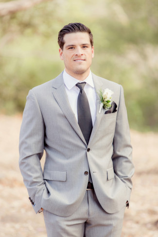Groom Wearing Gray Suit And Dark Tie With Cream Rose Boutonniere