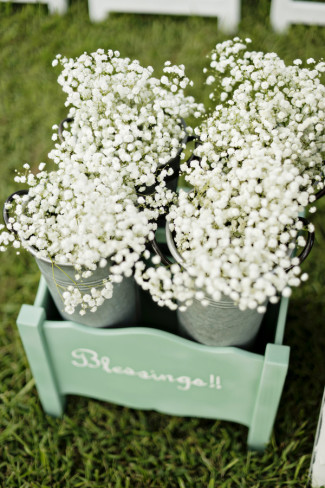 baby's breath in silver metal tins