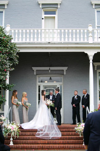 Outdoor Wedding ceremony on red brick stairs at PATRICK RANCH MUSEUM.