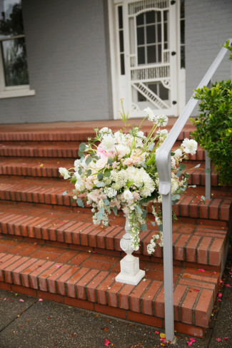 wedding ceremony floral arrangement on red brick stairs at PATRICK RANCH MUSEUM