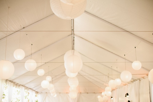 White Paper Lanterns hang from a tent ceiling