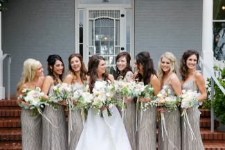 Bride standing with bridesmaids wearing taupe dresses at PATRICK RANCH MUSEUM
