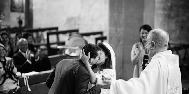 Bride and groom kissing during wedding ceremony in florence italy