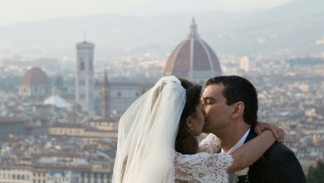 Bride and groom kissing with florence cityscape in the background