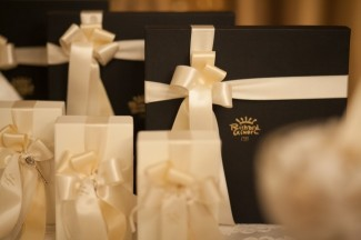 Brown boxes wrapped with cream ribbon for wedding guest gifts
