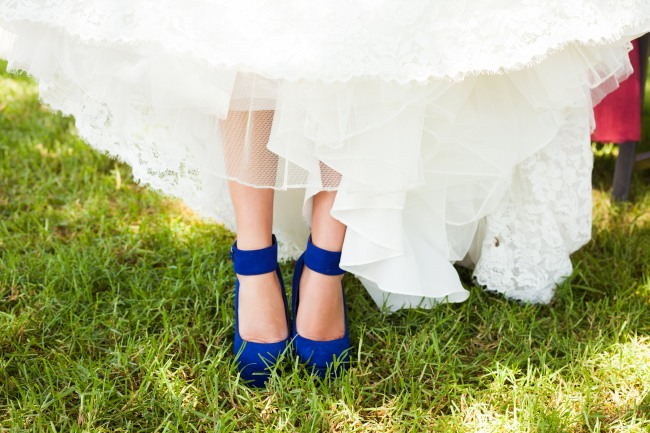 Bride wearing blue suede shoes with ankle straps
