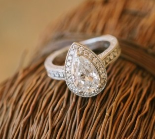Pear shaped halo diamond ring on straw bail