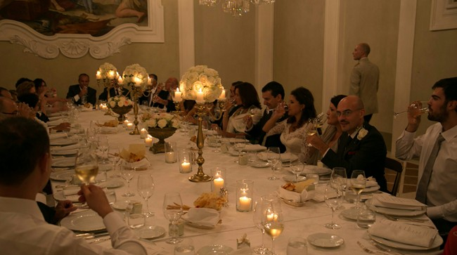 Wedding guests sitting around a long table in four seasons hotel in florence