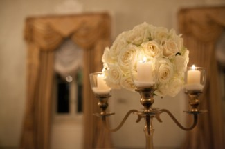 candelabra with white roses in the center