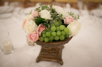 pink and white roses with green grapes for wedding receoption center piece