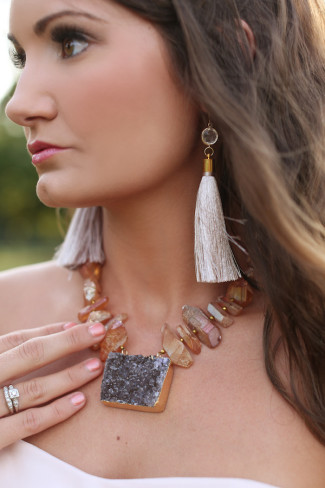bride wearing chunky stone necklace