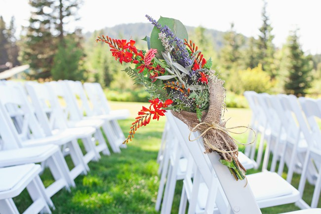 Wild flowers wrapped in burlap for ceremony aisle decor