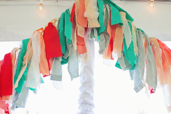 Pink, white, red, teal material strips for wedding decor garland